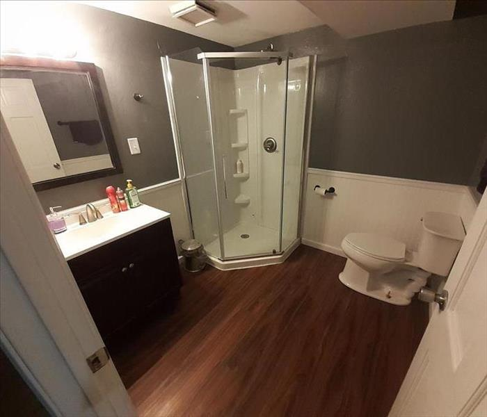 Clean basement bathroom with shower in corner